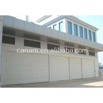 Automatic roll up garage door with pedestrian door