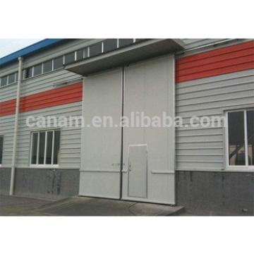 Sectional industrial sliding door