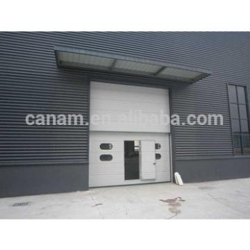 sectional garage door/industrial door with pedestrian door and windows kit
