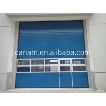 Color Steel Slat Sectional Industrial Sliding Door with Small Entry Door