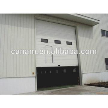 Sectional upward sliding lifting industrial door