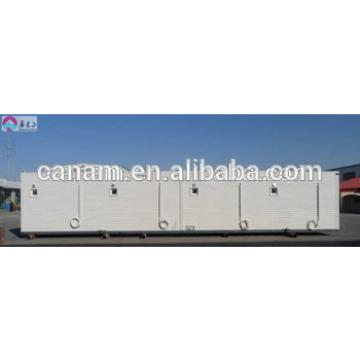 CANAM- modified shipping 40 ft container carport