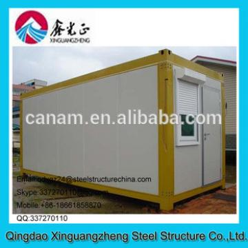 Flatpack container equipment house with single door and slide window