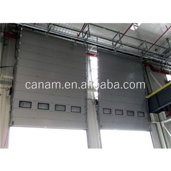 automatic industry vertical lift door with glass window and person entry door #1 image