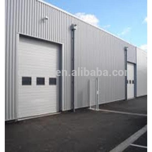 Standard lifting industrial section door #1 image