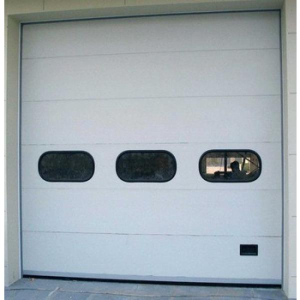 Accommodate automobiles and other vehicles insulated industrial electric garage door #1 image