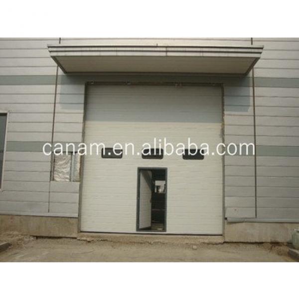 Security Sectional Steel Vertical Sliding Industrial Door with Pedestrian Door #1 image