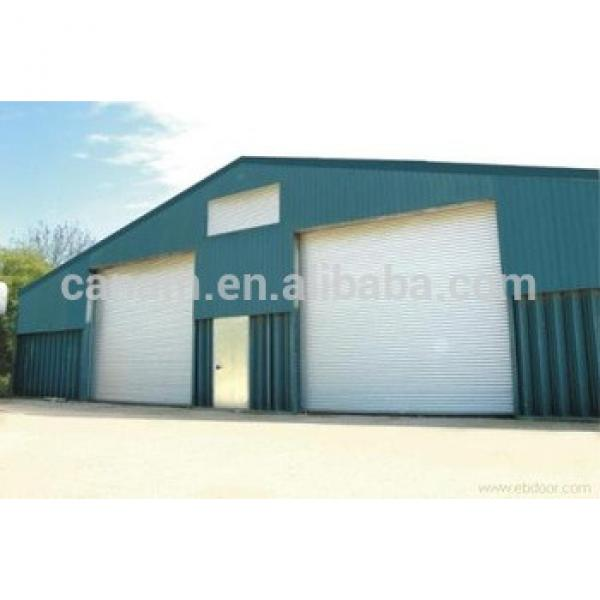 CE automatic color steel PU sandwich panel insulated industrial door,high lifting garage door #1 image