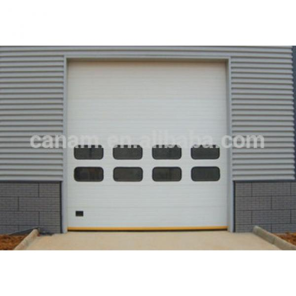 Sectional panel automatic industrial overhead door #1 image