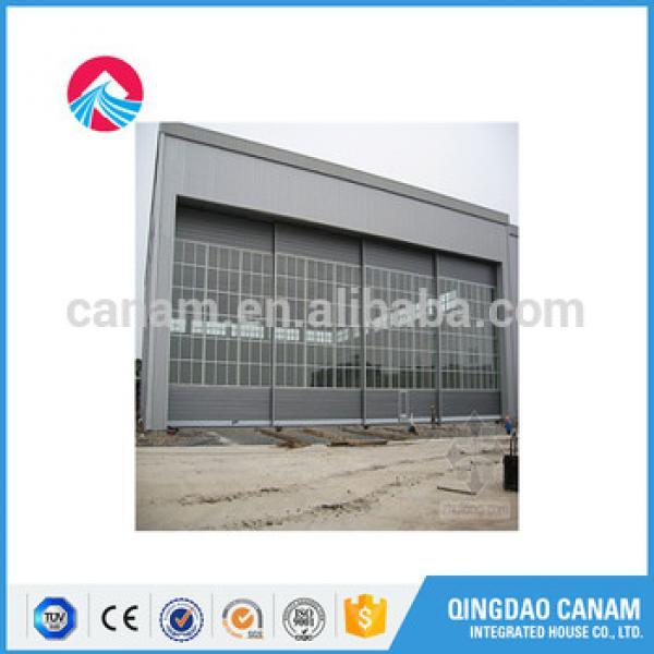 sectional garage door/industrial door with pedestrian doorand windows kit #1 image