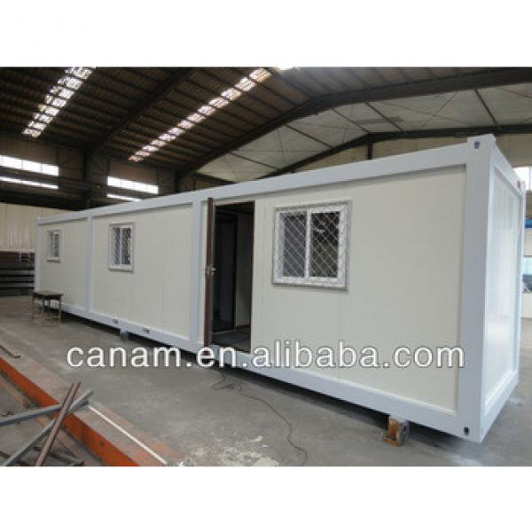 canam-portable flat pack container house #1 image