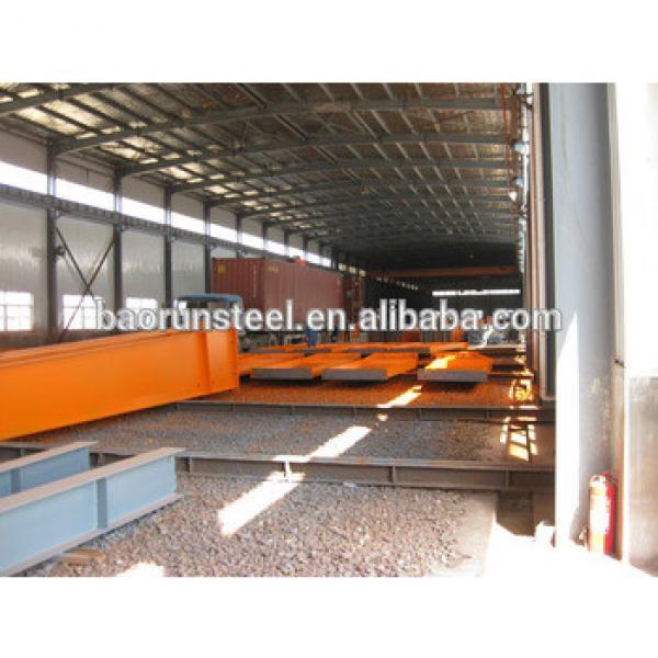 Qingdao high quality wide span light frame prefabricatd steel structure warehouse #1 image